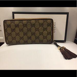 Authentic Gucci zip around wallet